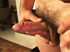 Horny beefy stud jerking his cock off on sofa for gay friend daddy gay porn